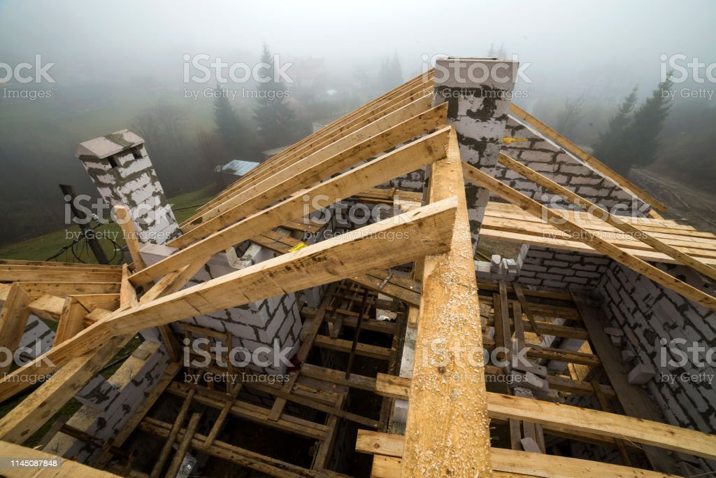 Top View Of Roof Frame From Wooden Lumber Beams And Planks On Walls