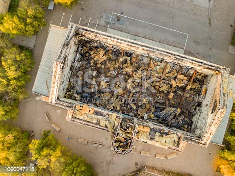 1015604922 istock photo top view of ruined damaged destroyed building after war f 1060047118