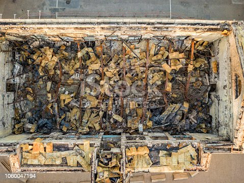 1015604922 istock photo top view of ruined damaged destroyed building after war f 1060047194