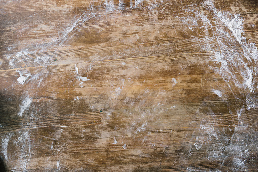 istock top view of rustic wooden table covered with flour 1032573178