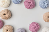 istock top view of scattered colored yarn balls  on white background 916245564
