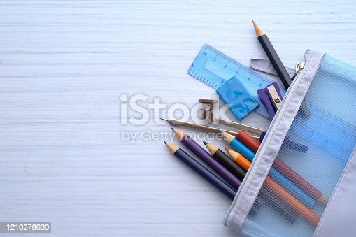 top view of school stationary on table with copy space.