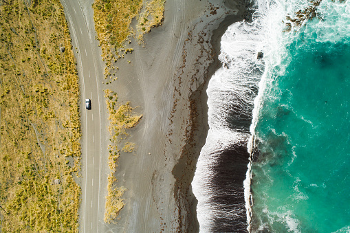Top view of sea, waves and road in Wairarapa Region, North Island, New Zealand.