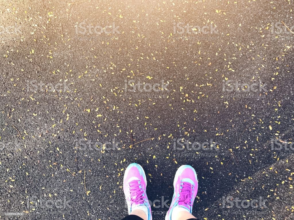 Top view of selfie pink sport shoes ,feet on concrete floor background, decision making , Choices concept, where to go, directions, business solutions, uncertainty stock photo
