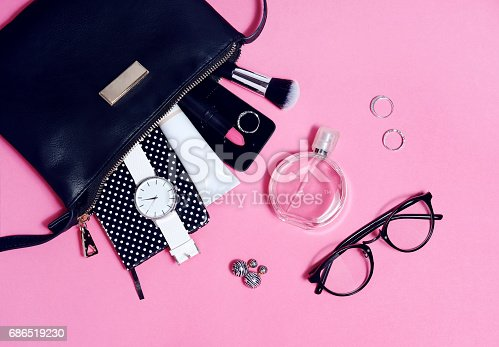 istock Top view of set female accessories on pink flat lay 686519230