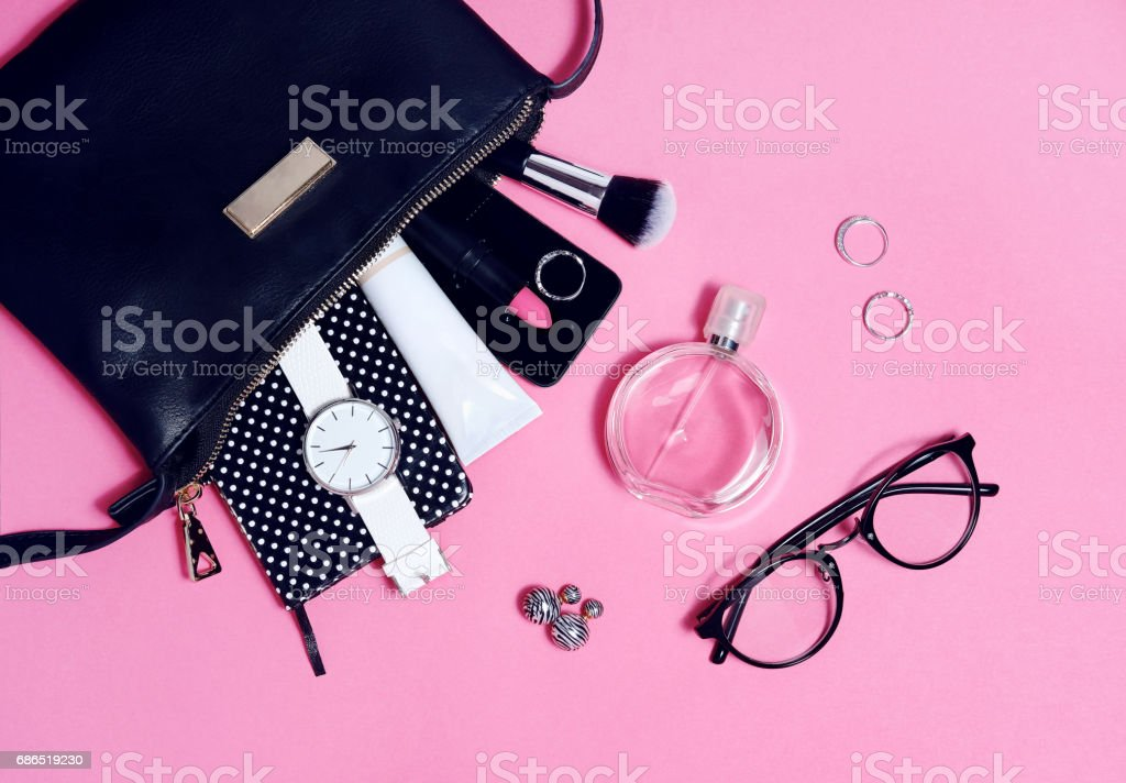Top view of set female accessories on pink flat lay stock photo