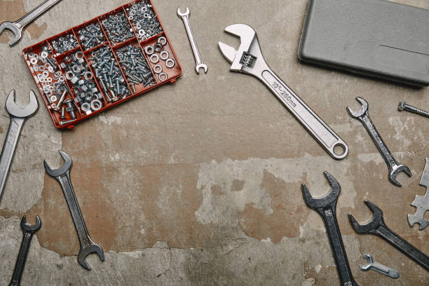 Top view of set of carpentry tools and box with screws on old surface Top view of set of carpentry tools and box with screws on old surface workbench stock pictures, royalty-free photos & images