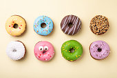 istock Top view of set of donuts on yellow background. Flat lay, copy space. 1206815227