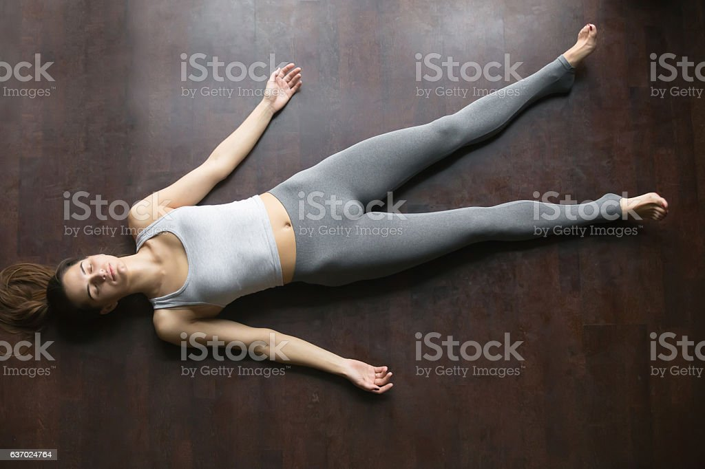 Top view of Shavasana yoga posture stock photo