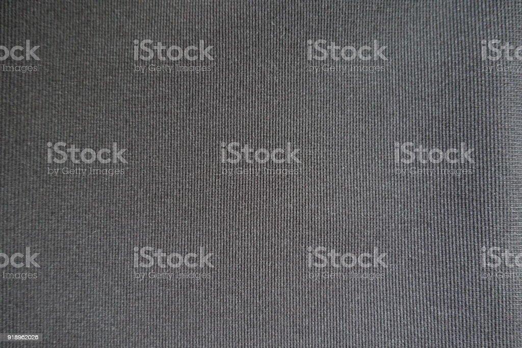 Top view of simple dark gray fabric stock photo
