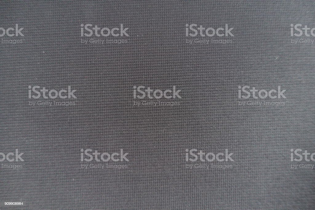 Top view of simple dark grey fabric stock photo