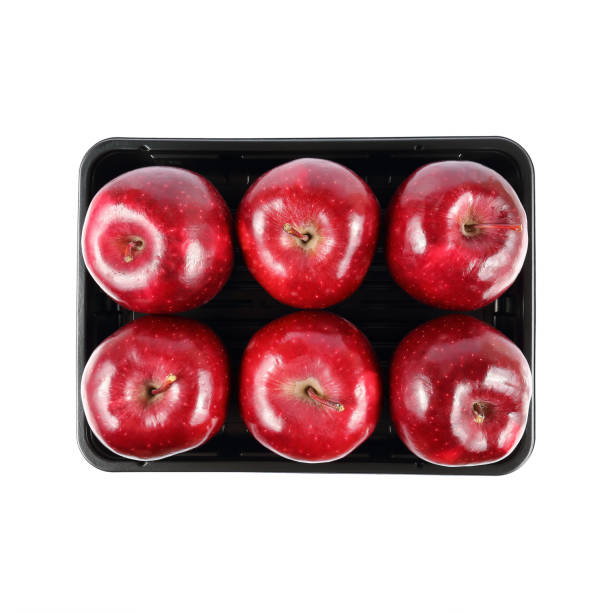 top view of six red apples on black tray isolated on white stock photo