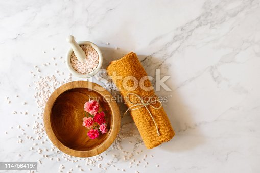 istock Top view of spa set with towels flower and stone. Relaxation concept 1147564197