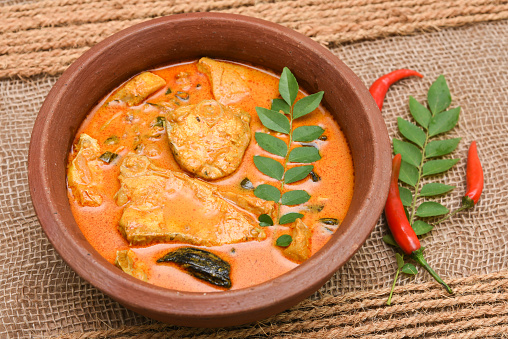 istock Top view of spicy and hot king fish curry Kerala Indian food 667669040