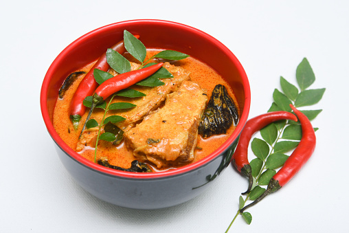 istock Top view of spicy and hot king fish curry Kerala Indian food 667671664