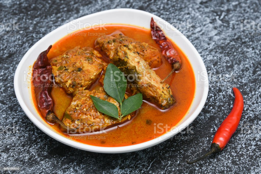Top view of spicy and hot king fish curry with cooked tapioca stock photo