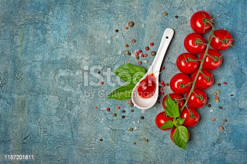 istock Top view of spicy tomato ketchup sauce with Cherry tomatoes and basil leaves 1157201811