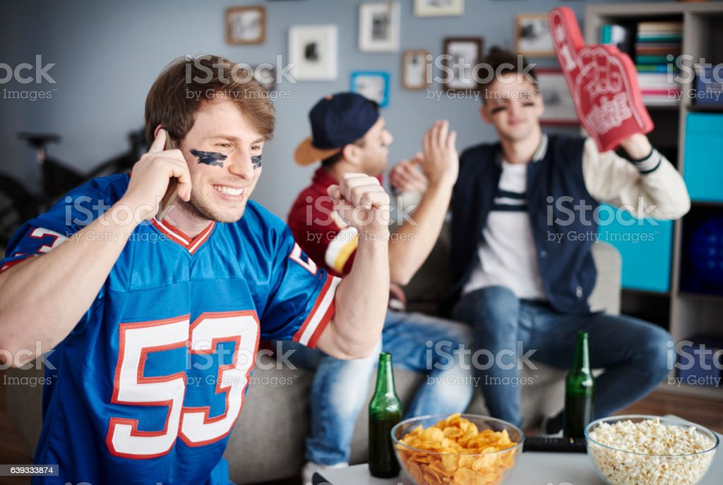 Top view of sports fan using cell phone stock photo