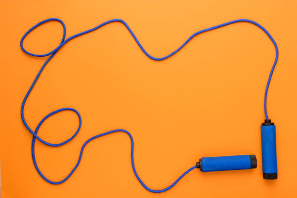 top view of sports jumping rope isolated on orange, sport background concept stock photo