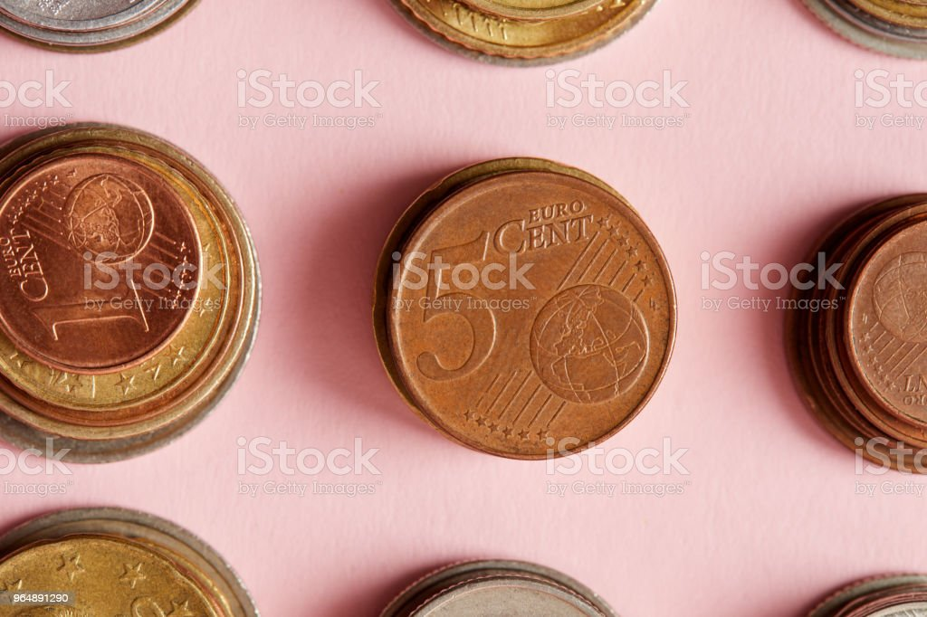 top view of stacks of various coins on pink royalty-free stock photo