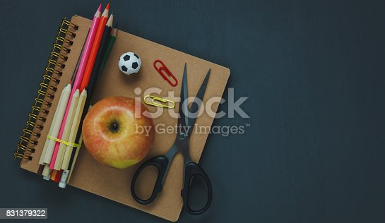 istock Top view of stationery education or business office desk concept.essential object on dark wood background.Copy space for free text design. 831379322