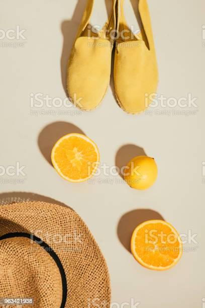 Top view of straw hat lemon orange slices and yellow stylish picture id963421938?b=1&k=6&m=963421938&s=612x612&h=v6yt0edtvyxcitebohnlpbmu3chntf08dx4oprgaube=