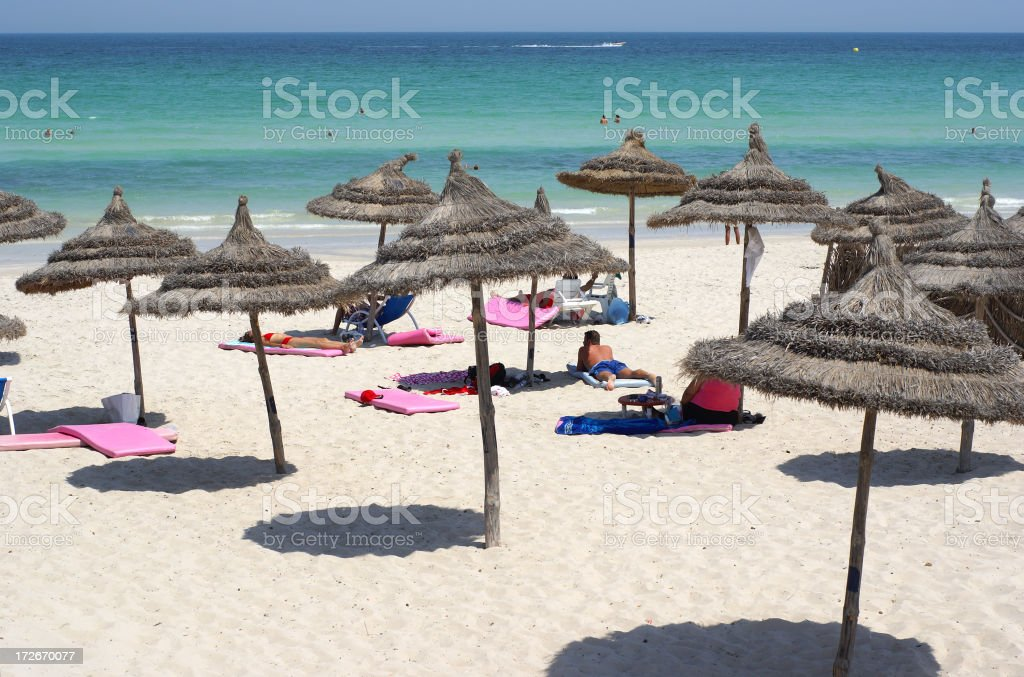 Top view of straw umbrellas on sandy beaches of the Bahamas stock photo