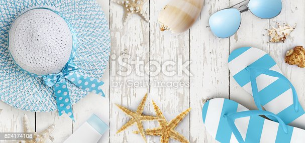istock Top view of summer beach accessories on wooden white background, vacation and travel concept 824174108
