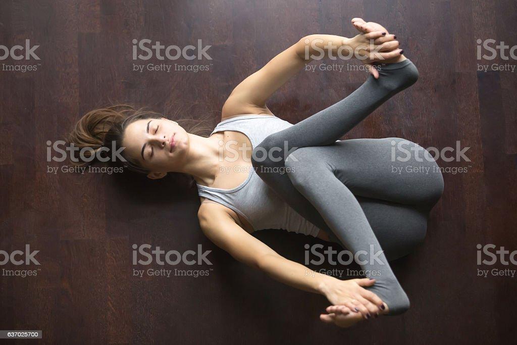 Top view of Supta Gomukhasana yoga pose stock photo
