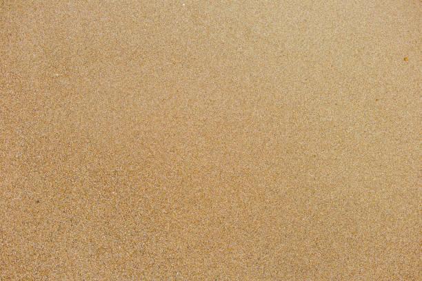 widok z góry na powierzchni czystego złotego piasku na plaży morskiej - piasek zdjęcia i obrazy z banku zdjęć
