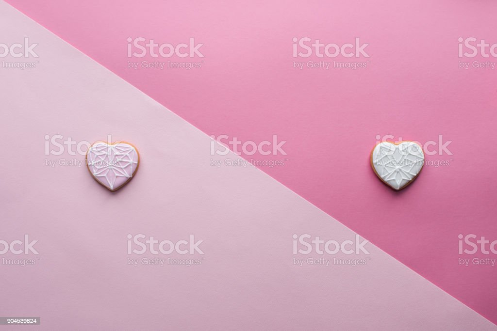 top view of sweet heart shaped cookies on pink, st valentines day concept stock photo