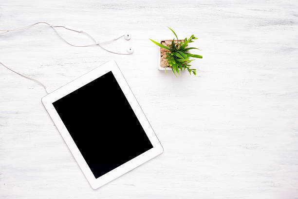 top view of tablet computer on wooden table - einfache holzprojekte stock-fotos und bilder