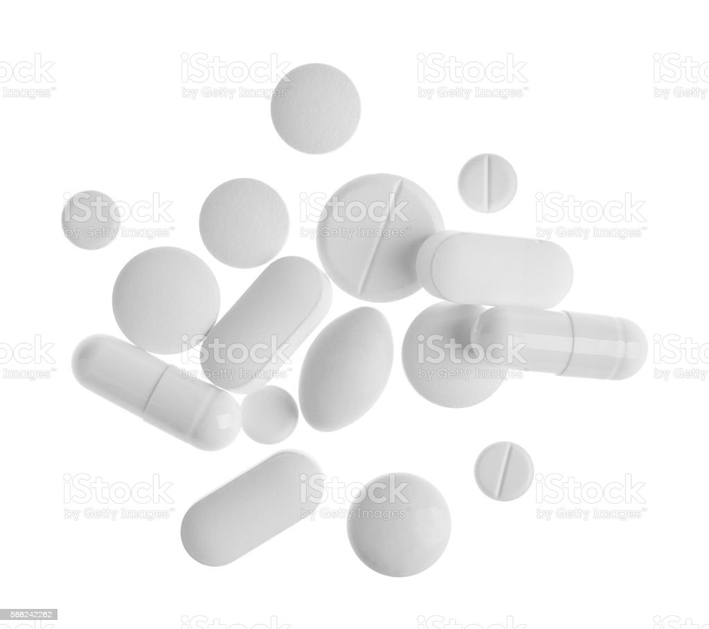 Top view of tablets and capsules isolated on white background stock photo