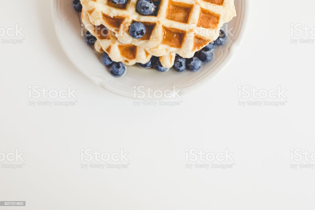 top view of tasty fresh waffles with blueberries with copy space stock photo