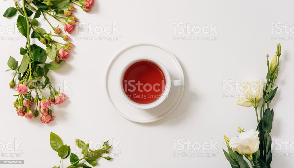Top view of tea cup surrounded by flowers stock photo