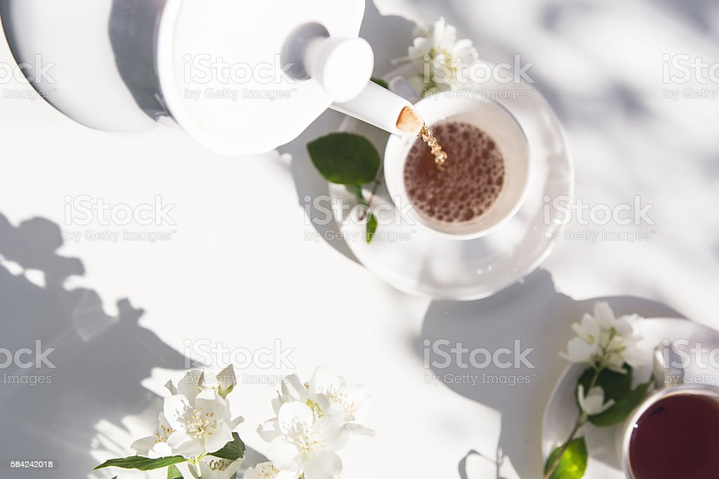 Top view of tea pot flow of tea in the stock photo