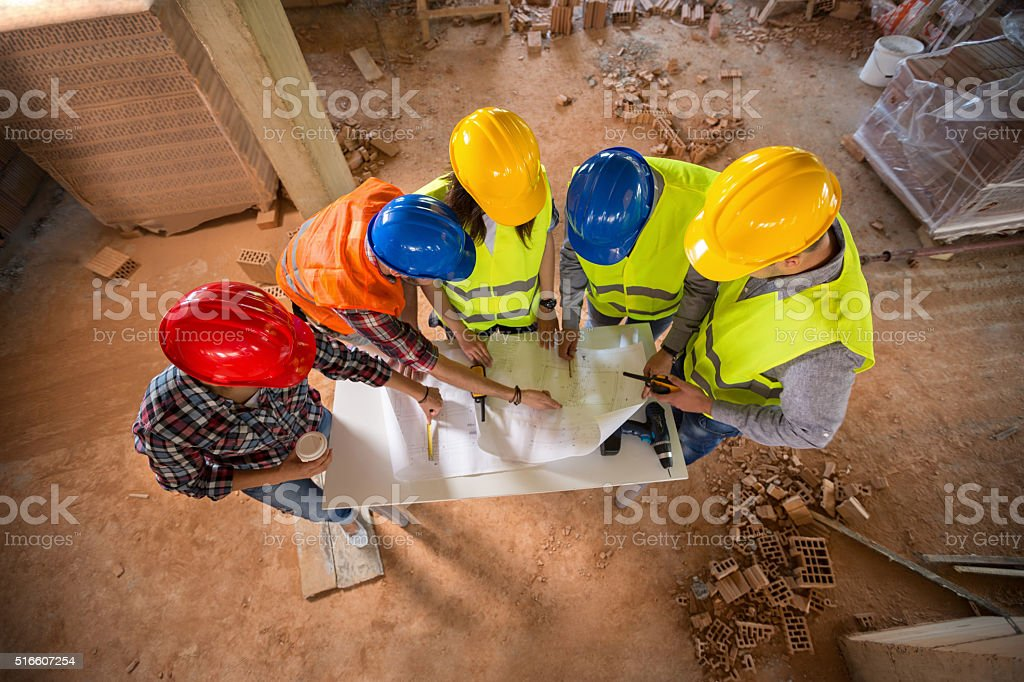 Top view of team on building construction stock photo