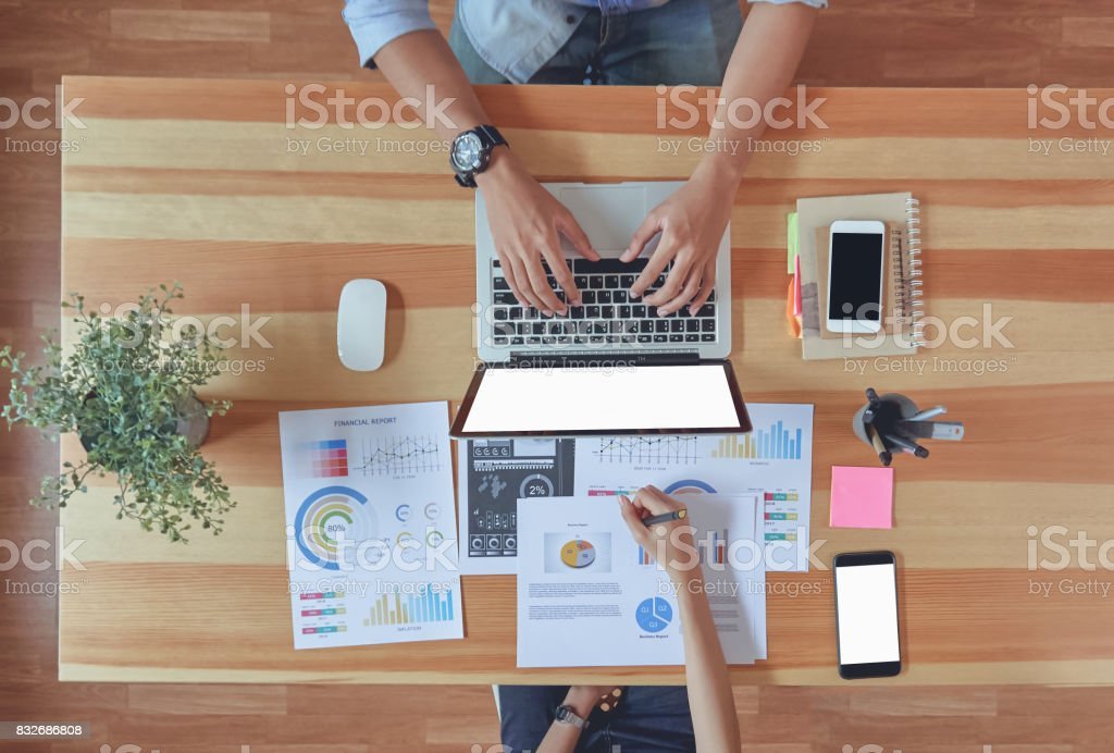 Top View of teamwork helps us select the best information. To bring to customers to use in successful work. Quality work concept, vintage effect. stock photo