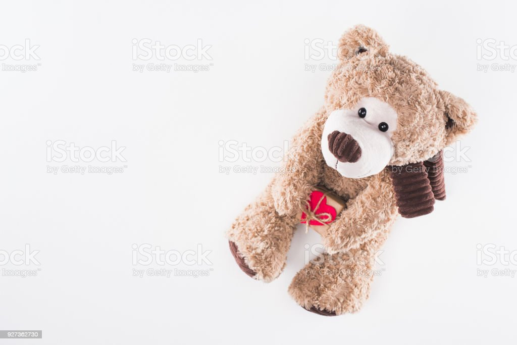 top view of teddy bear with heart shaped gift box isolated on white, valentines day concept - Royalty-free Box - Container Stock Photo
