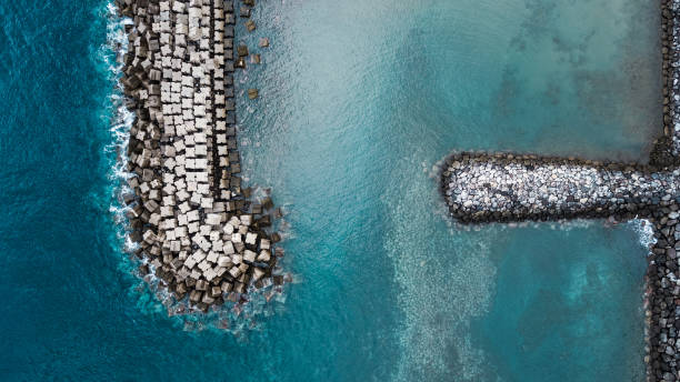 top view of tetrapods drone top view of concrete tetrapods on water groyne stock pictures, royalty-free photos & images
