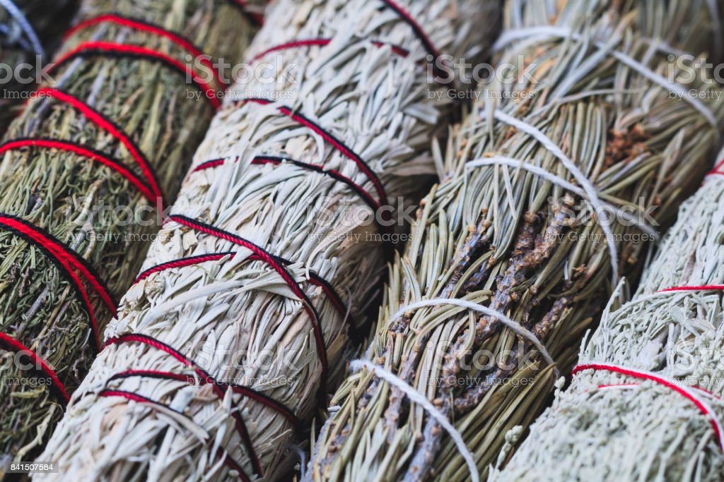 Top view of the bandaged branches of dried herbs: sage, wormwood, pine and juniper stock photo