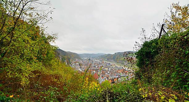 top view of the city dinant with its church. - maasvallei stockfoto's en -beelden