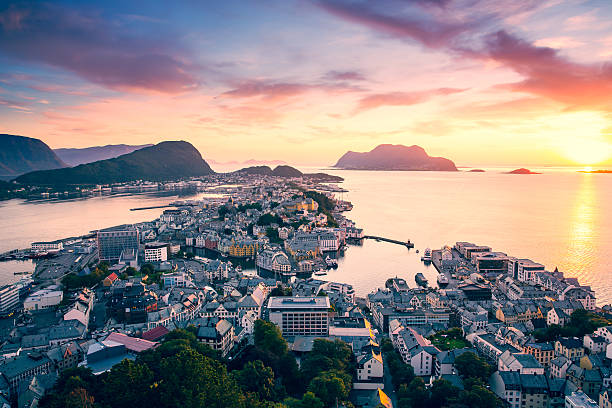 Top view of the city of Alesund at sunset . stock photo