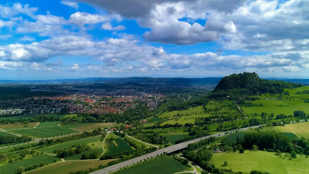 Top view of the city of Singen in Germany. Hegau district, where the ruins of an old castle on a volcano. Top view of the city of Singen in Germany. Hegau district, where the ruins of an old castle on a volcano. singen stock pictures, royalty-free photos & images