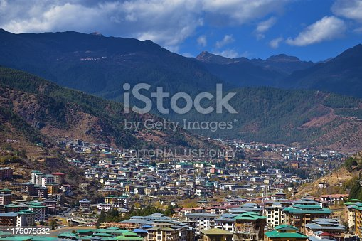 Thimphu, Bhutan - December 7, 2018: Top view of the densely packed dwellings down the hill in the valley of Thimphu.