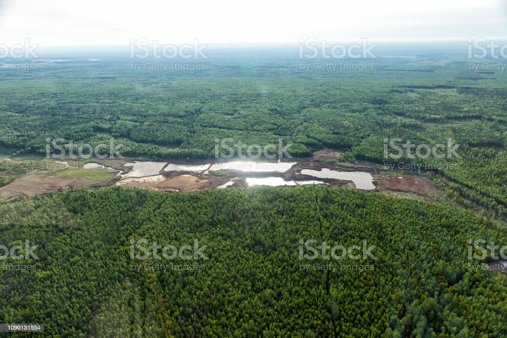 Top view of the riverbed forest after gold mining. Gold mining with...