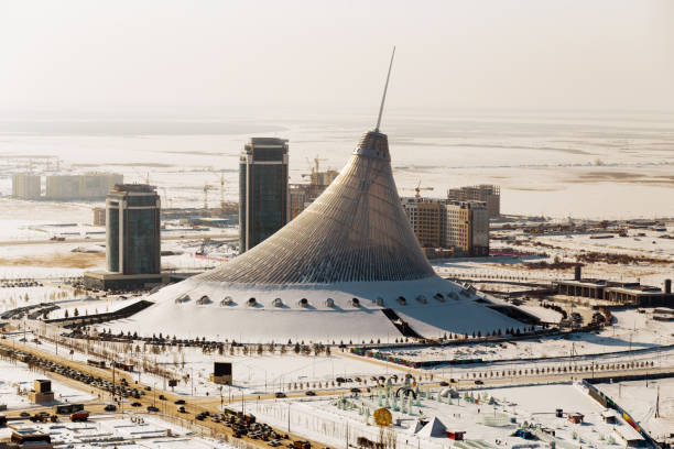 Top view of the shopping center Khan Shatyr in winter on a sunny day in Astana, Kazakhstan stock photo