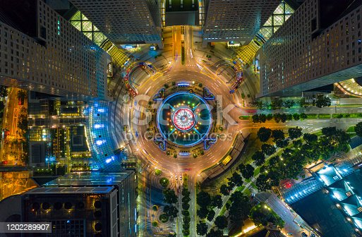 Top view of the Singapore landmark financial business district with skyscraper. Fountain of Wealth at Suntec city in Singapore at night
