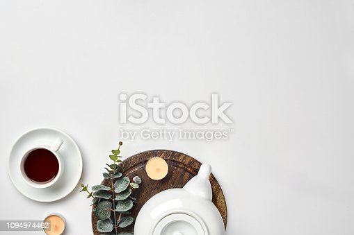 Top view of the tea pot and tea cup on white background. copy space. Flat lay. Still life