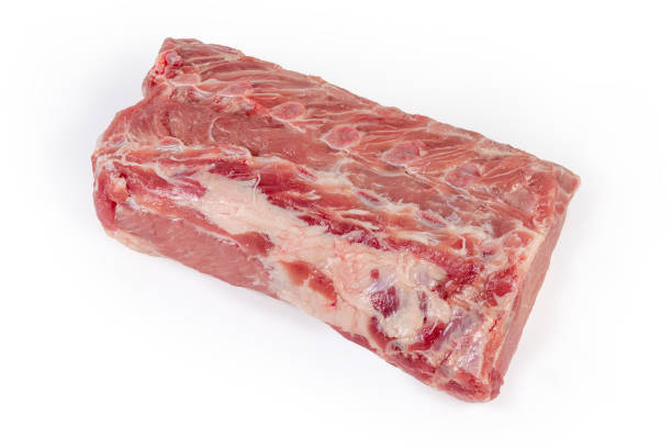 Top view of the uncooked pork loin on white background stock photo